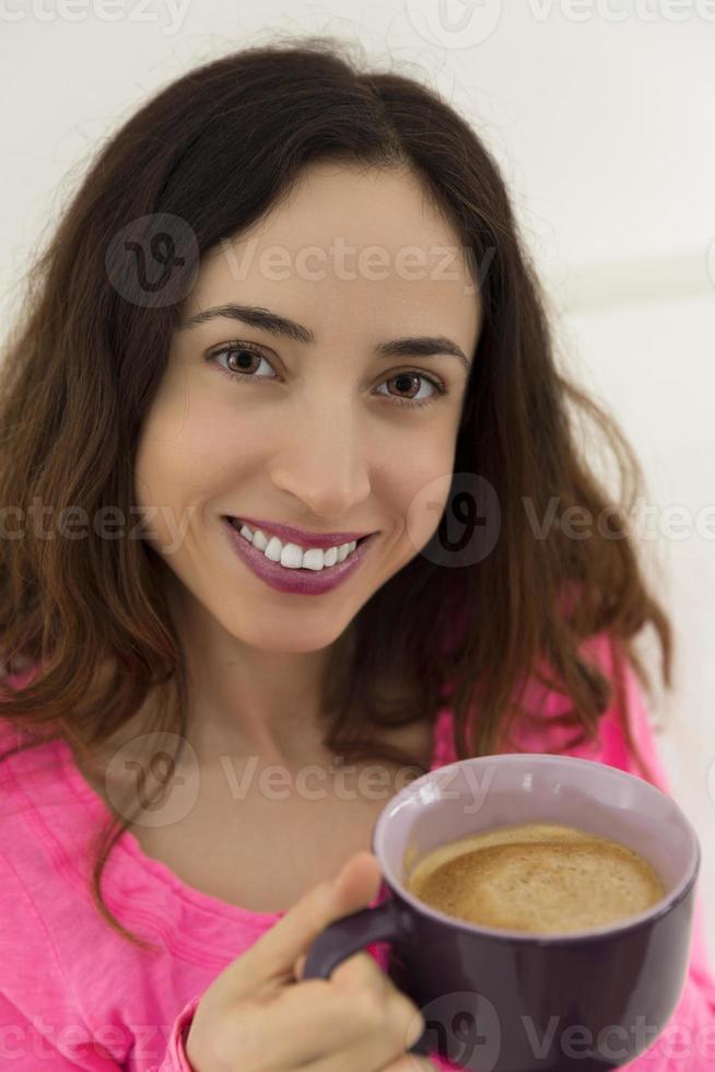 Woman enjoying her coffee photo
