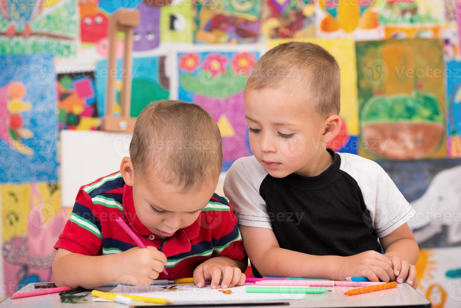 Two brothers enjoy drawing photo
