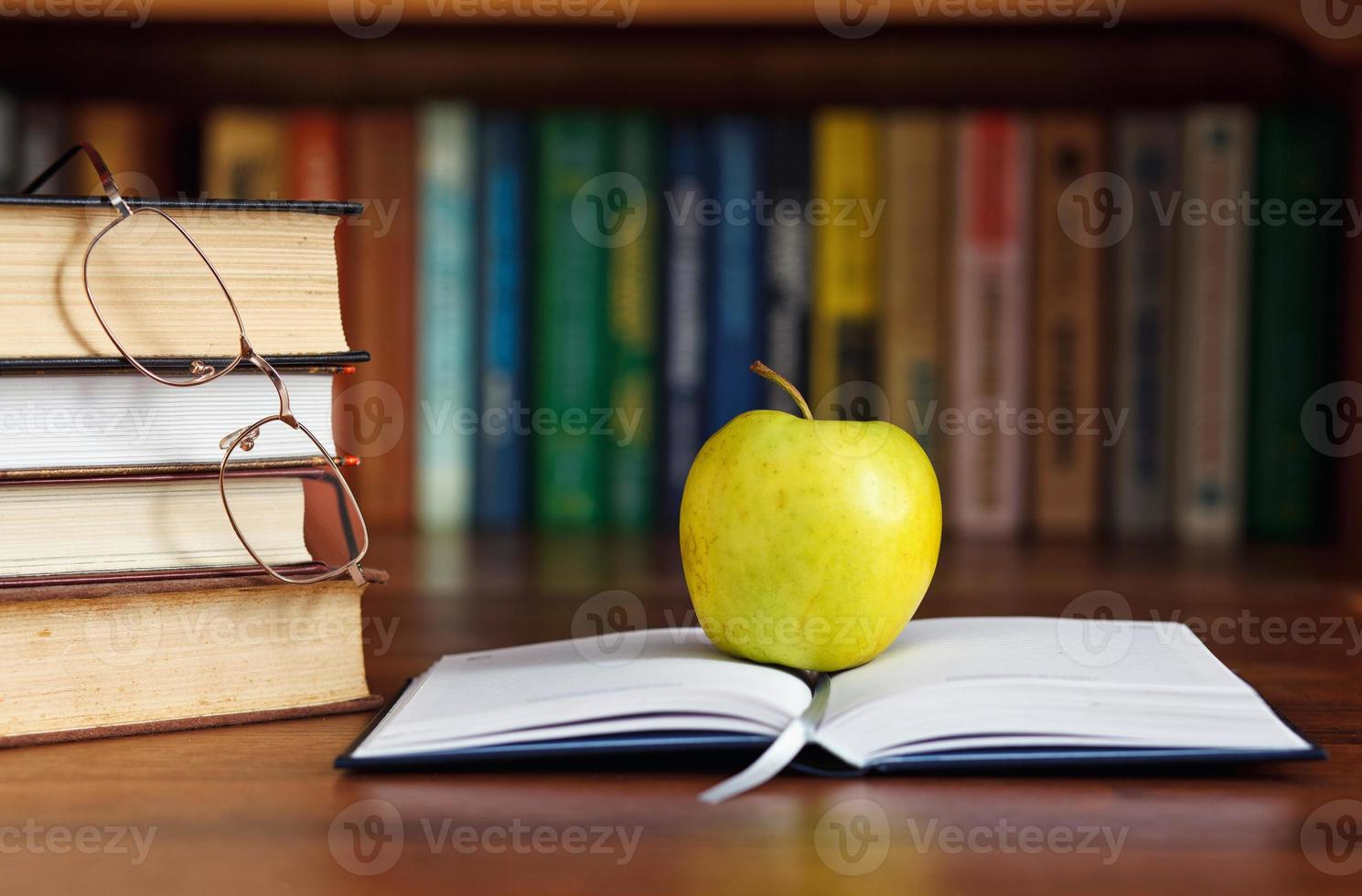 apple on the open book photo