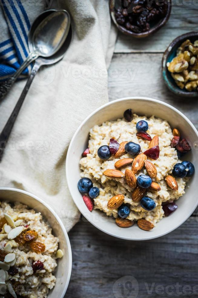 Oatmeal with berries and nuts photo