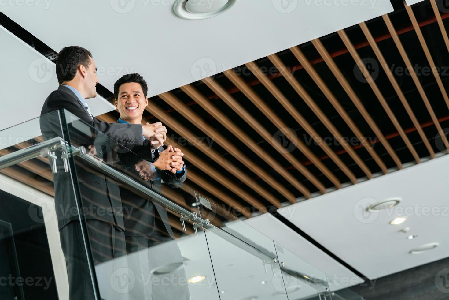 Talking businessmen photo