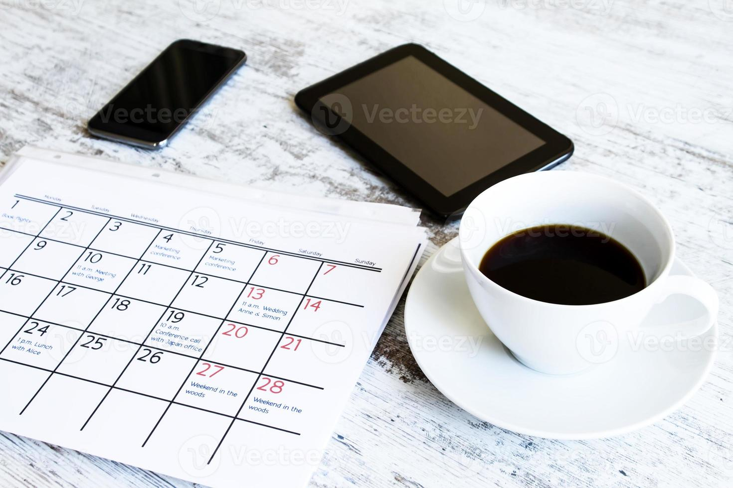 Checking monthly activities in the calendar photo