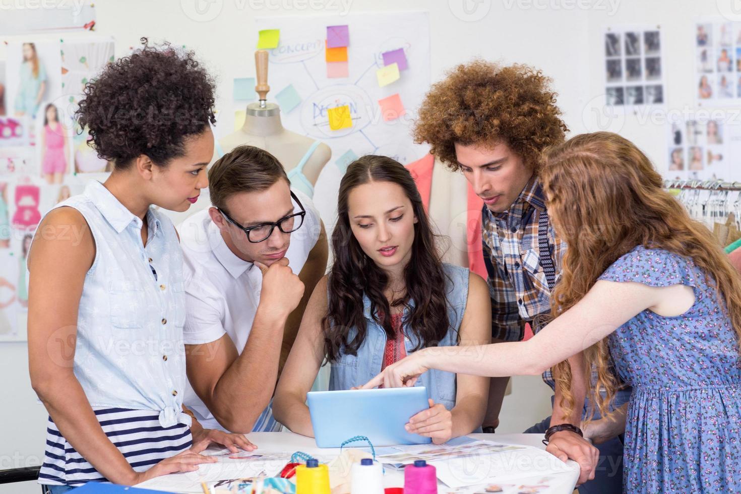 Designers using digital tablet photo
