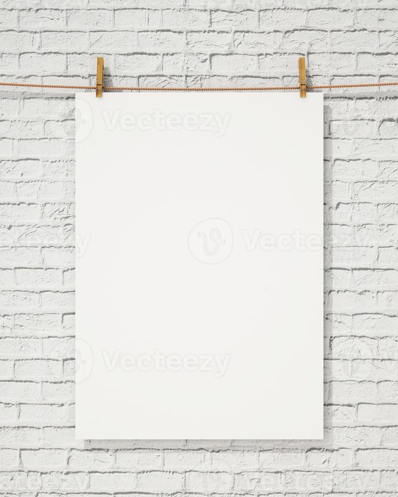 blank white hanging poster with clothespin and rope photo