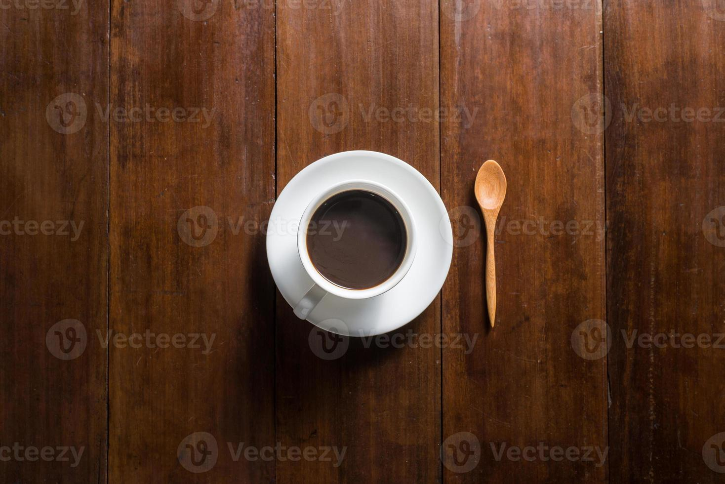Coffee cup on wooden background, top view photo