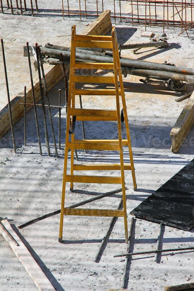 Yellow staircase on the construction site photo