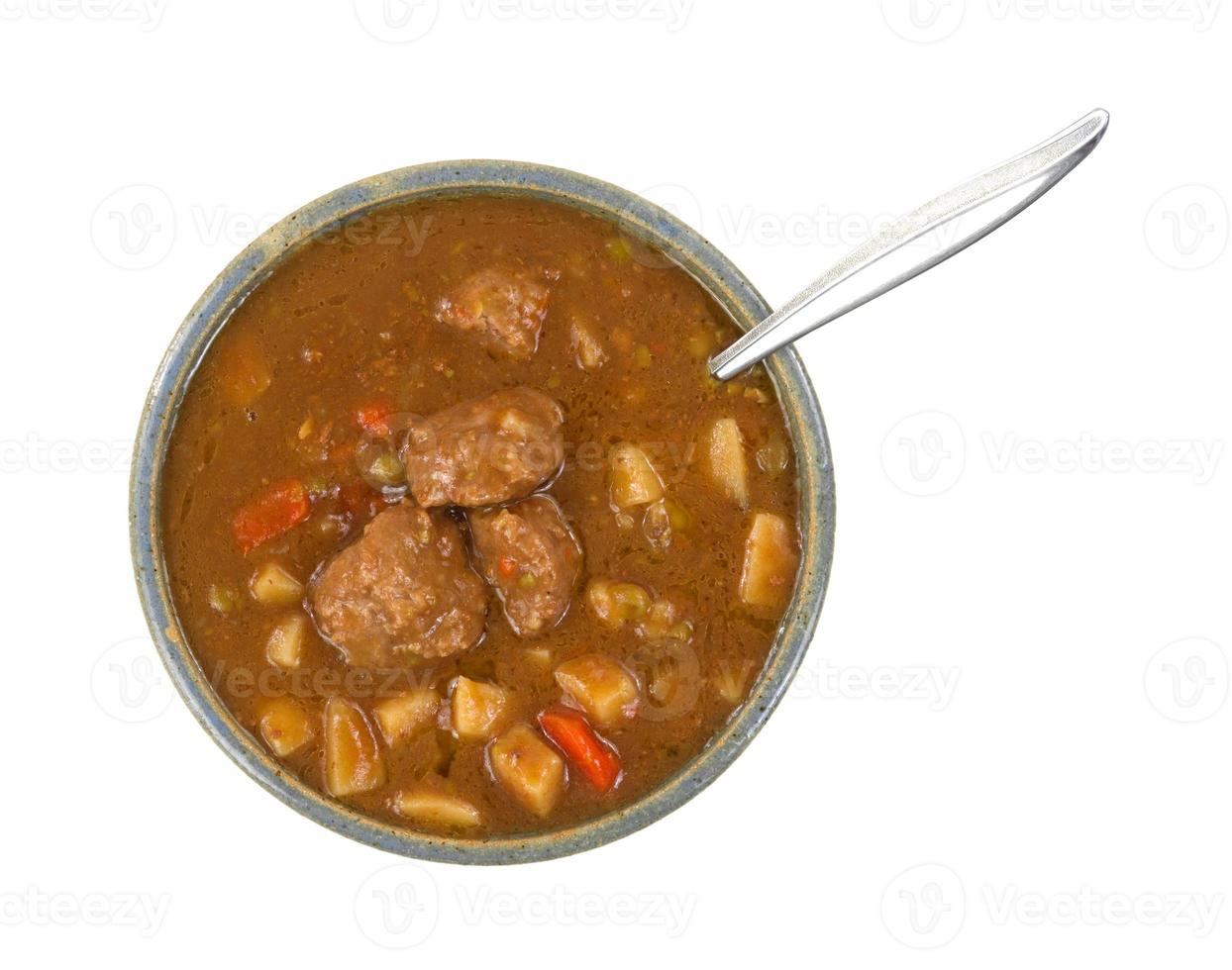 Bowl of meatball stew with a spoon photo