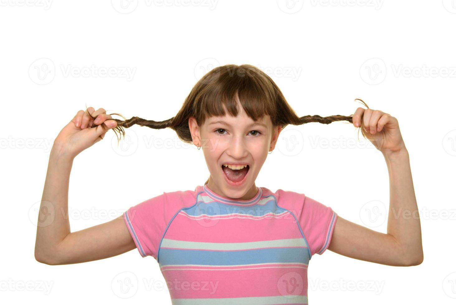 niña feliz con trenzas foto