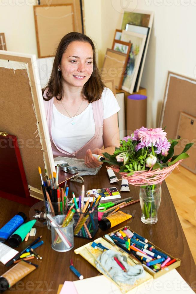 young artist paints a picture photo