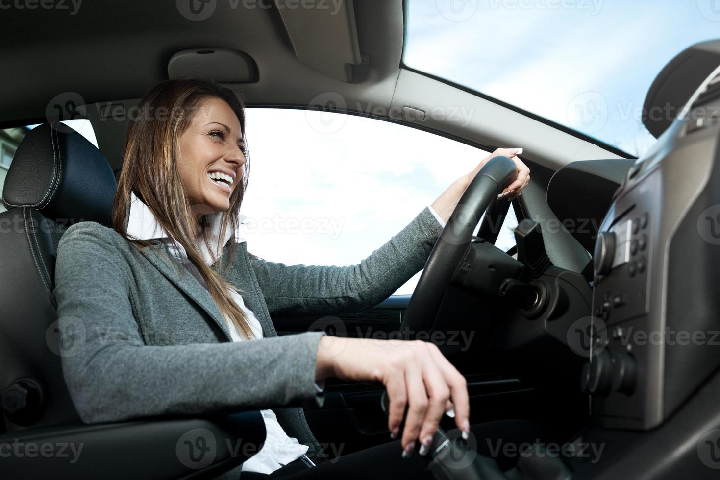 Young smiling woman driving photo