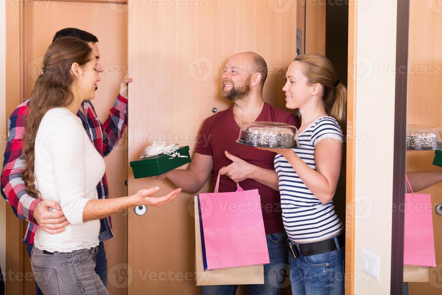 Happy guests in doorway photo