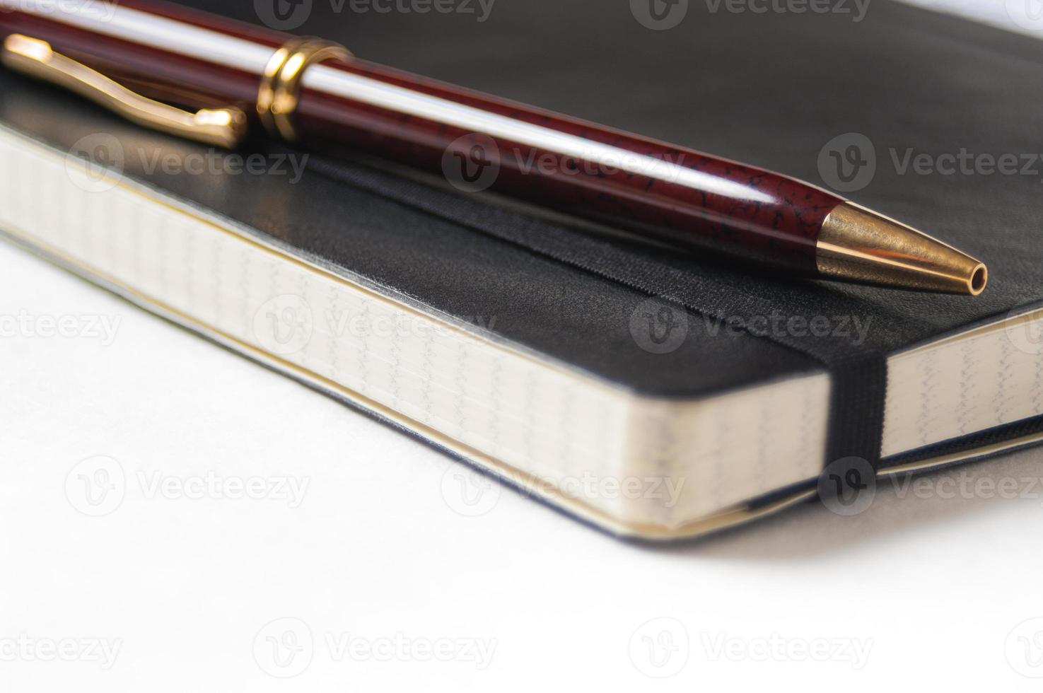 Closeup of a pen and notebook photo