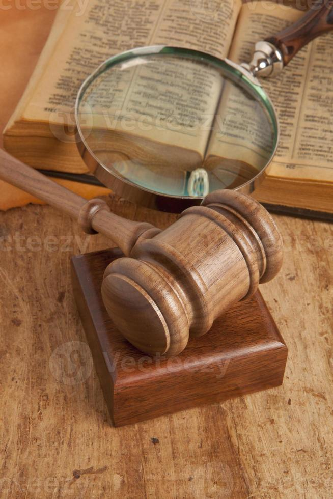 Wooden gavel and books photo