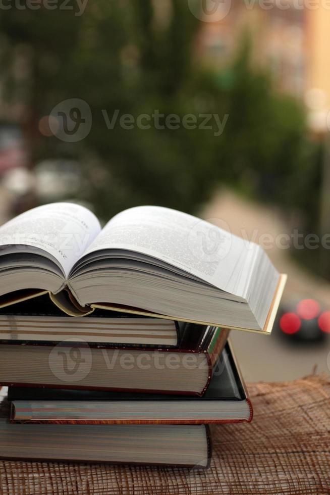 stack of books on city background photo