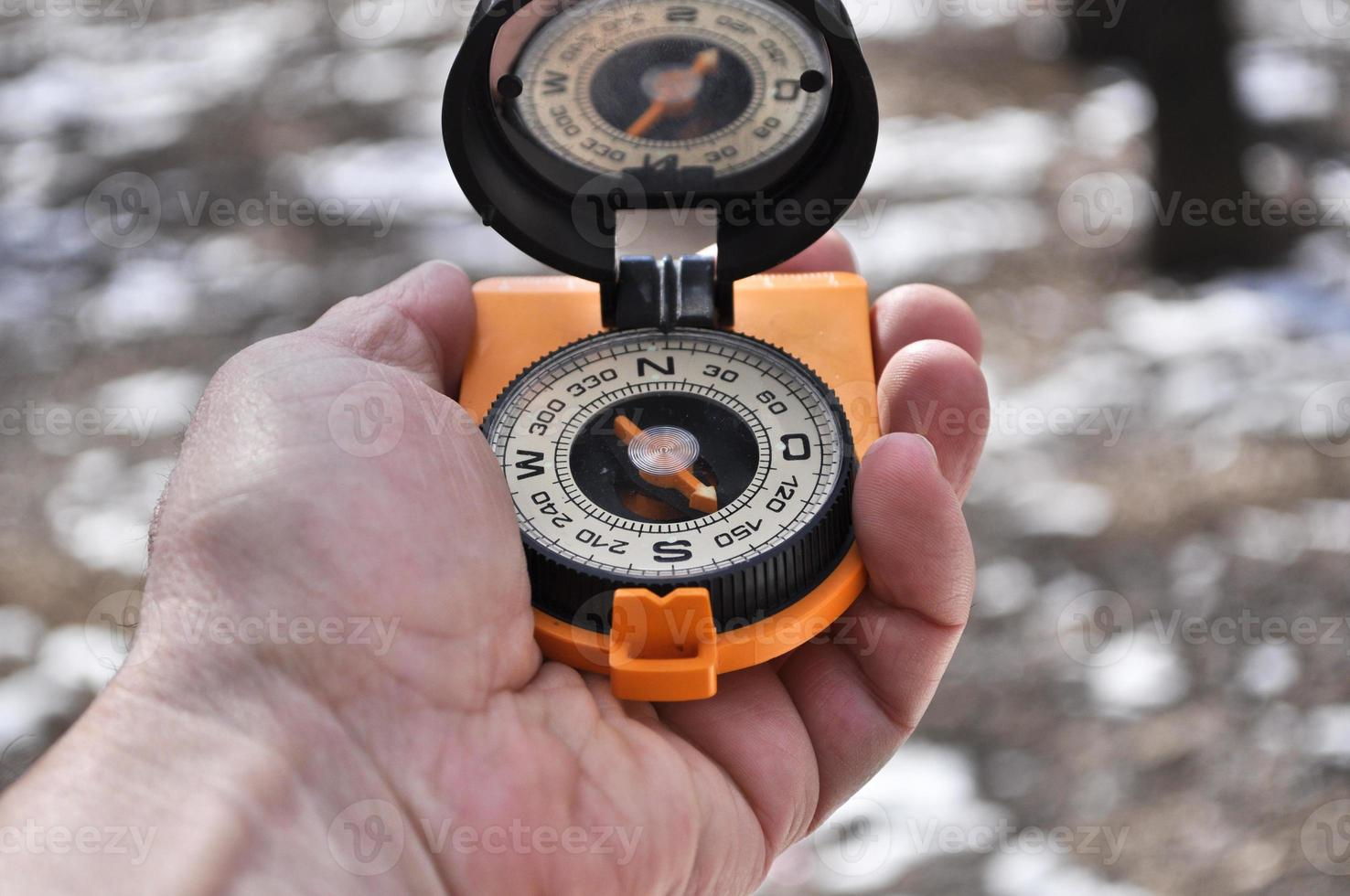 The compass in his hand. photo