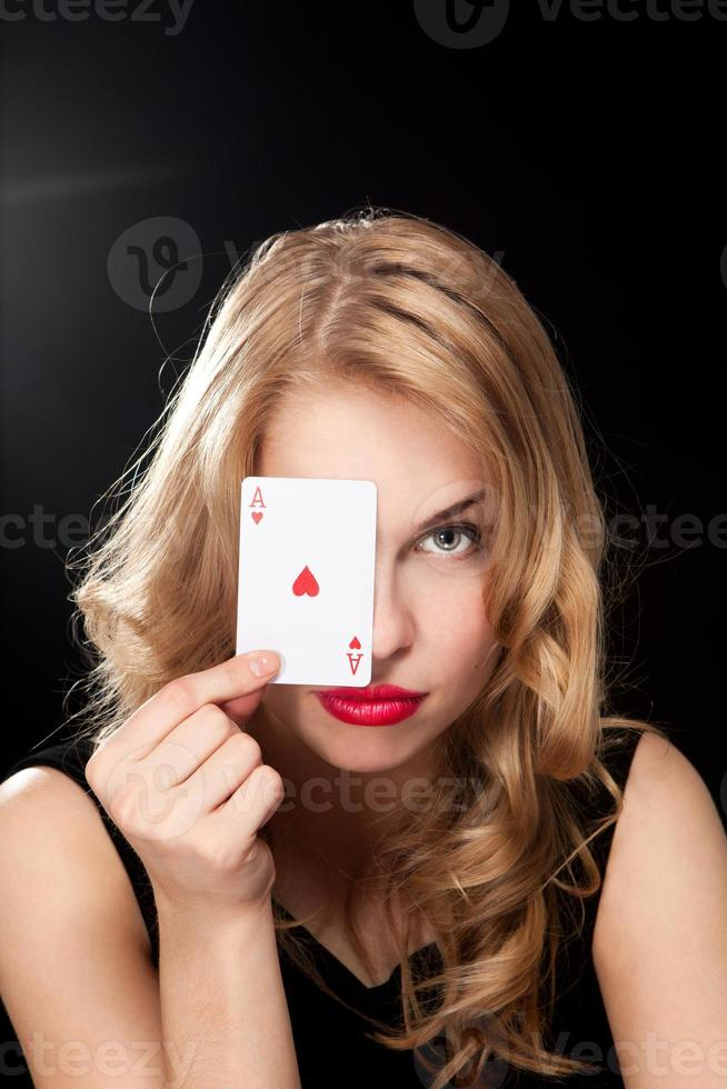 Young woman playing in the gambling photo