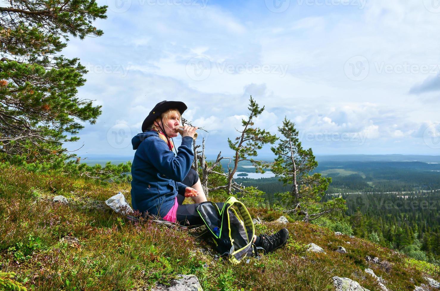 Hiker drinking photo