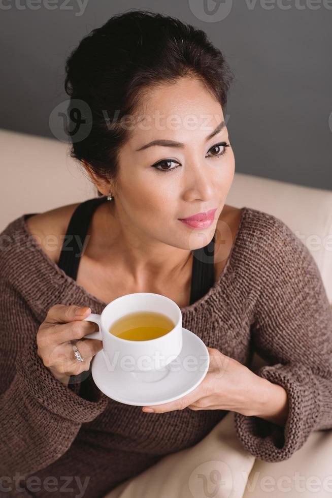 Drinking green tea photo