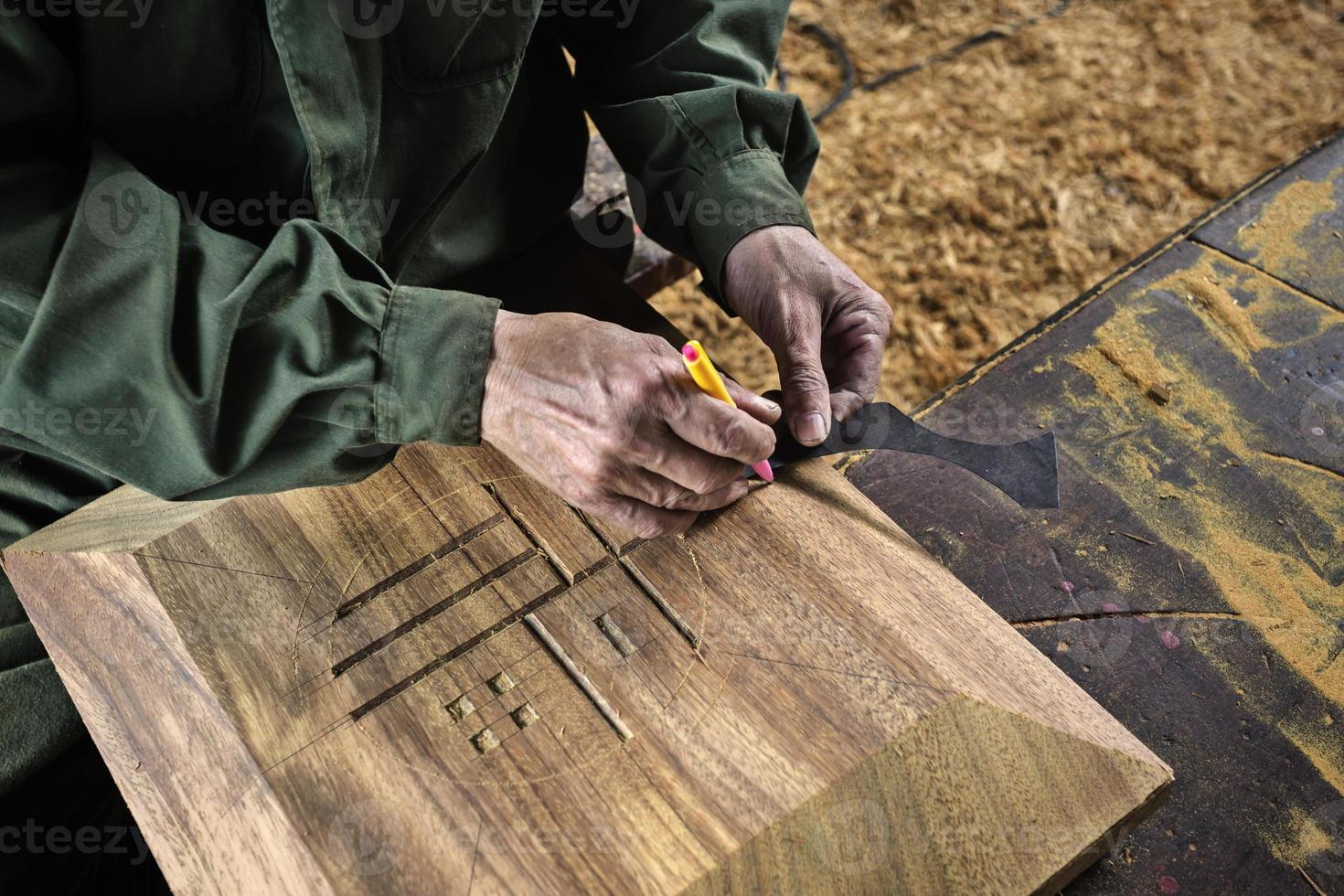hand of carpenter taking measurement photo