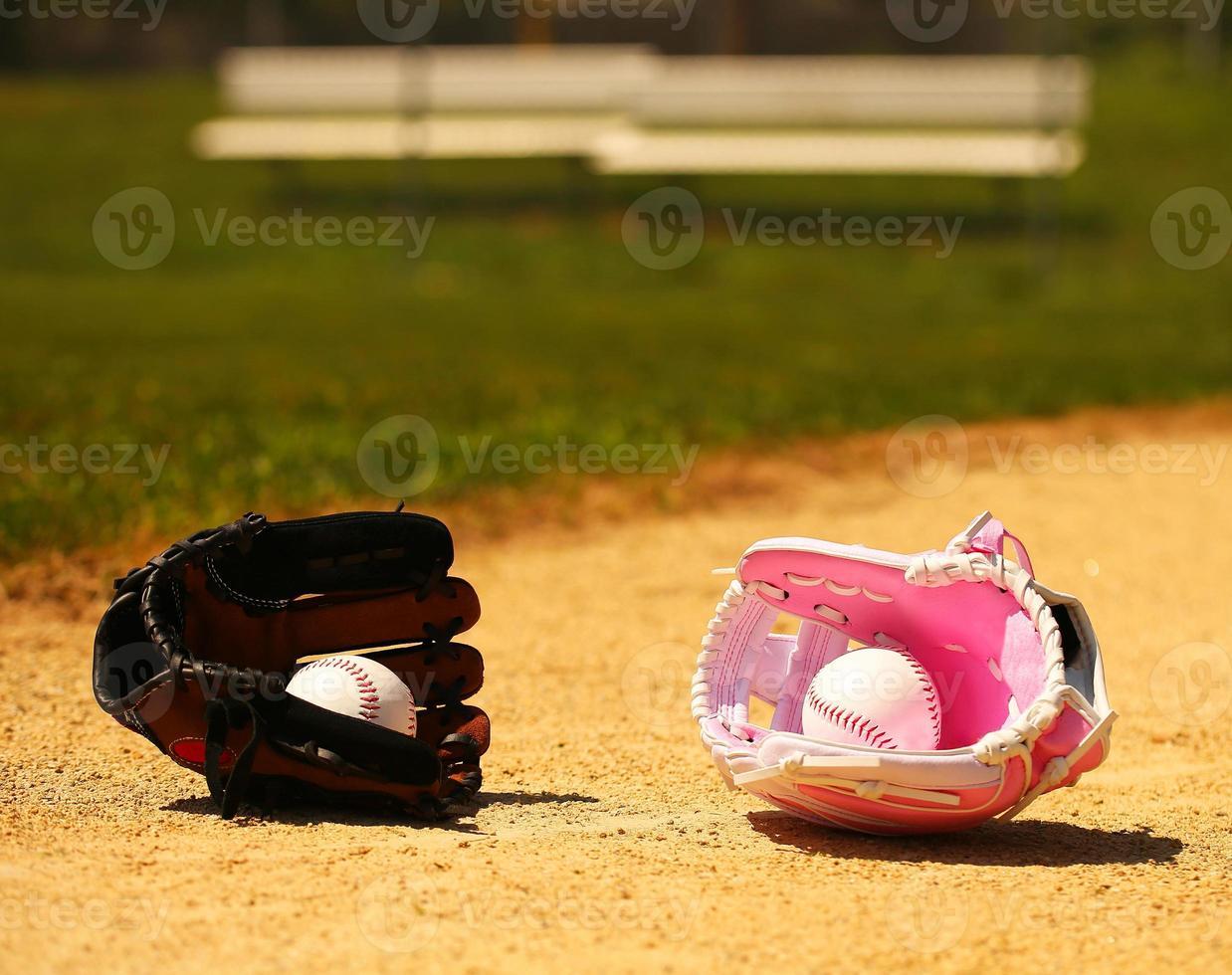 Baseball. Balls in Gloves on Green Grass. Female vs Male photo