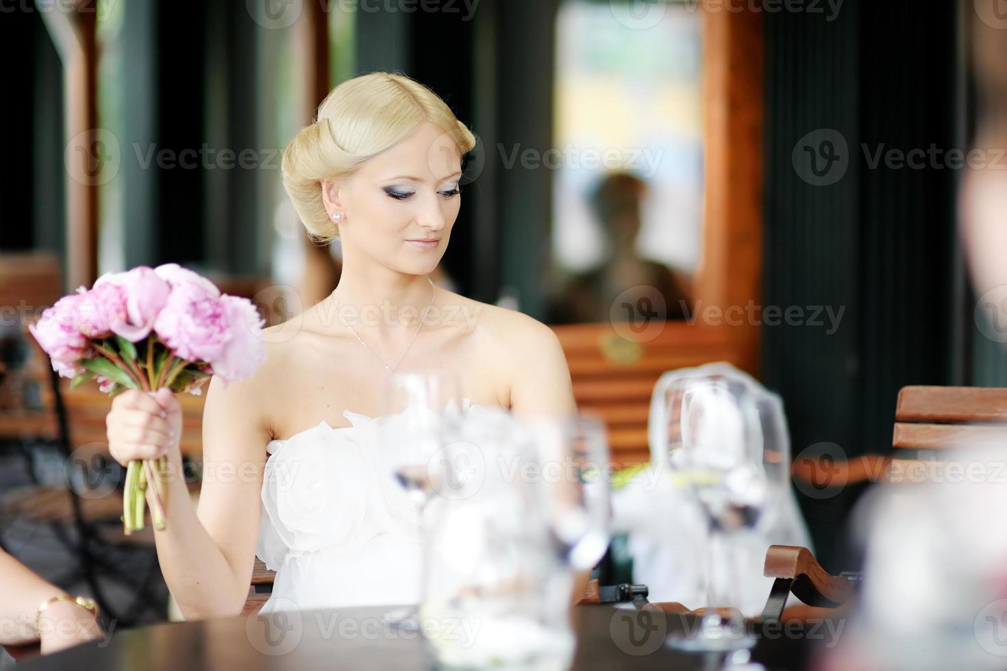 Bride drinking champagne photo