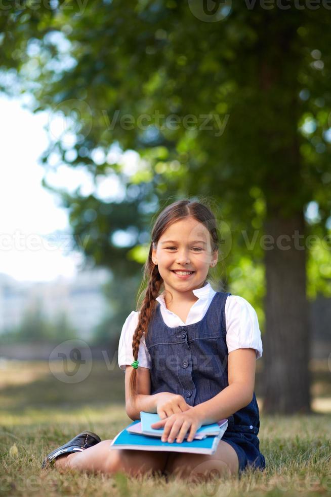 Schoolgirl in park photo