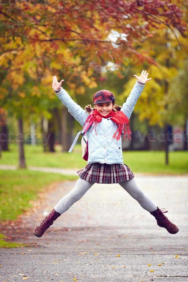 Schoolgirl jumping photo