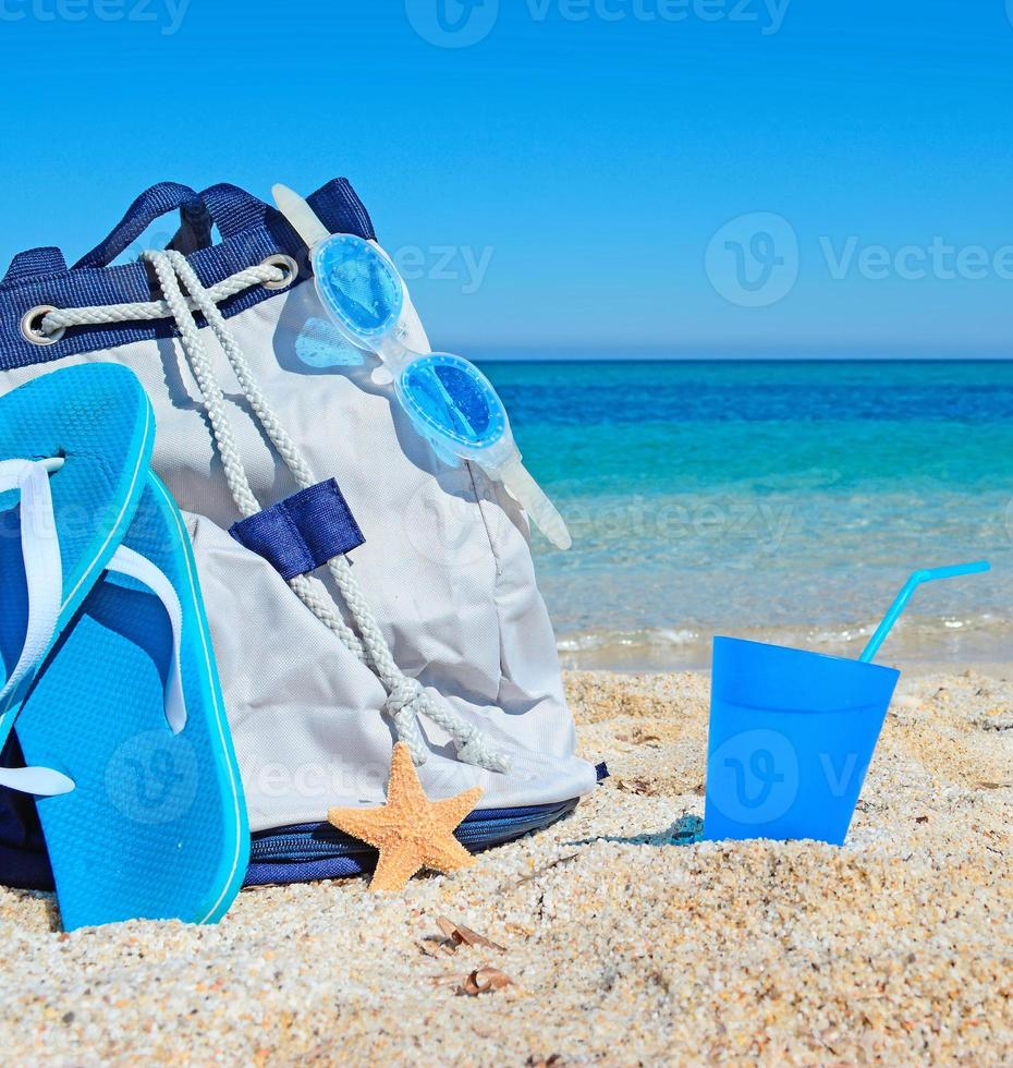 bag, sandals and drink photo