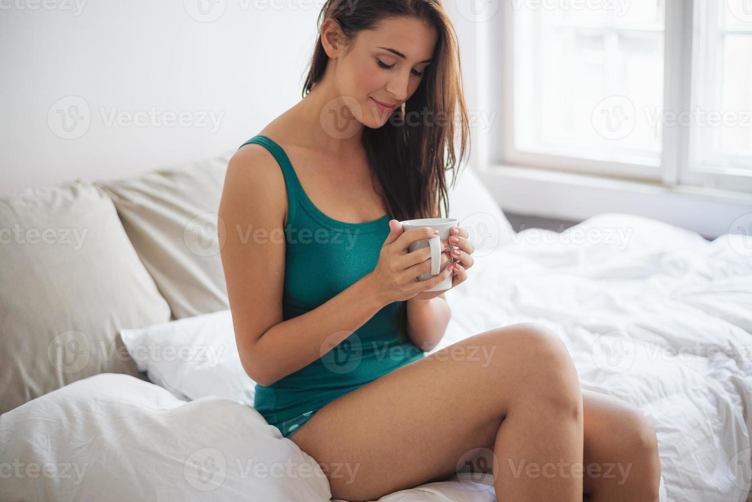 Drinking coffee in bed photo