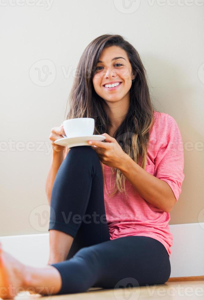 young woman drinking tea photo