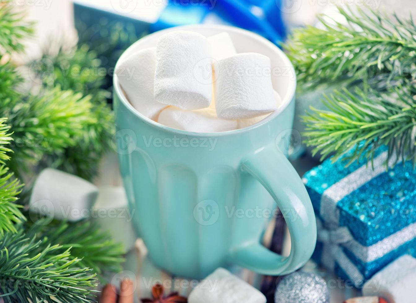 Hot drink with marshmallows photo
