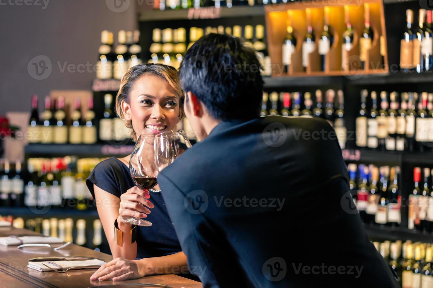 Asian couple drinking red wine photo