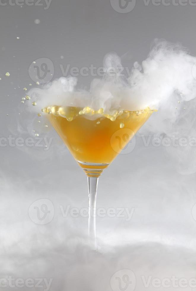 Splash drink with white smoke photo