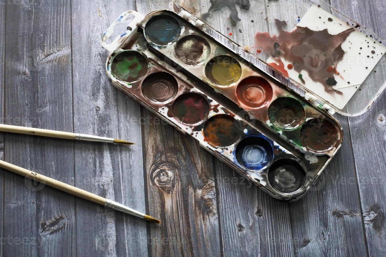 old watercolor paints and brushes photo