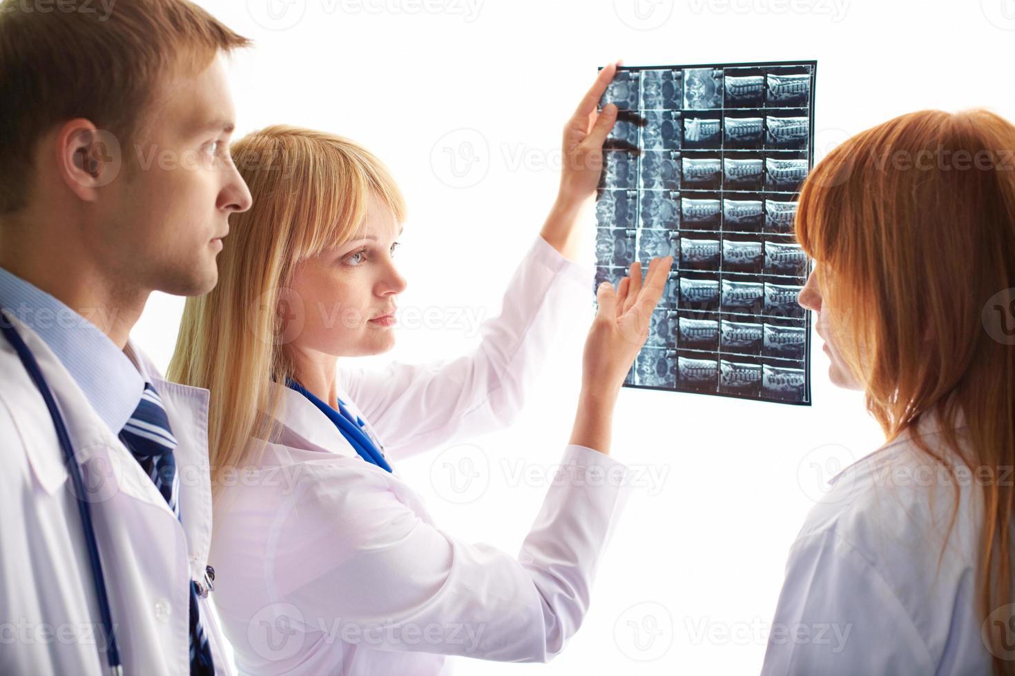 Looking at x-ray photograph photo
