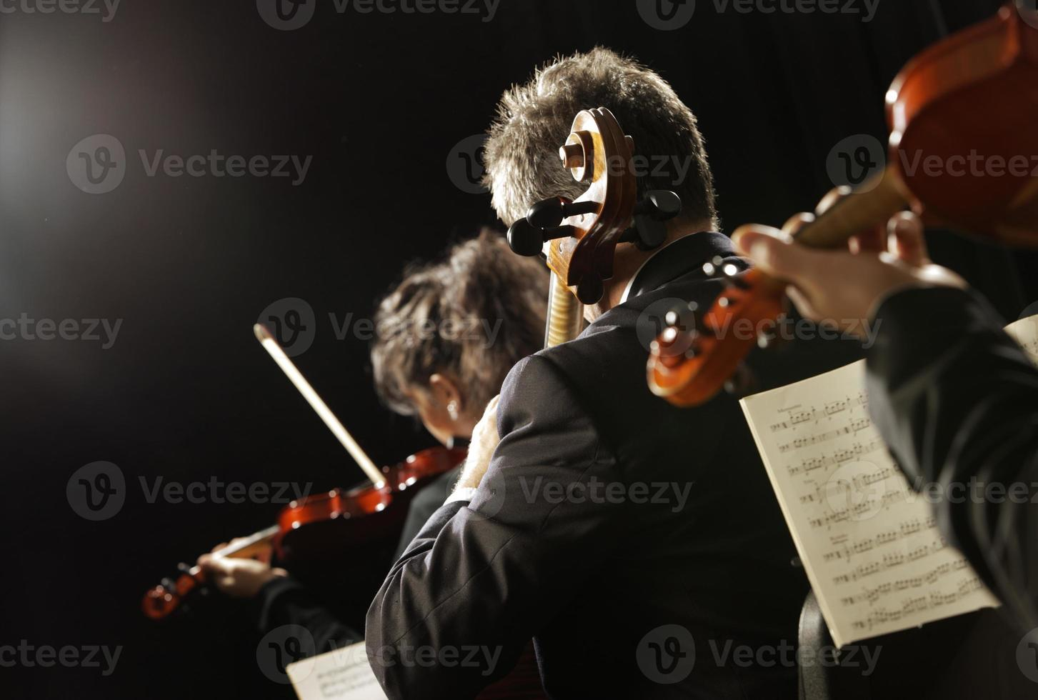 Violinists playing classical music at a concert photo