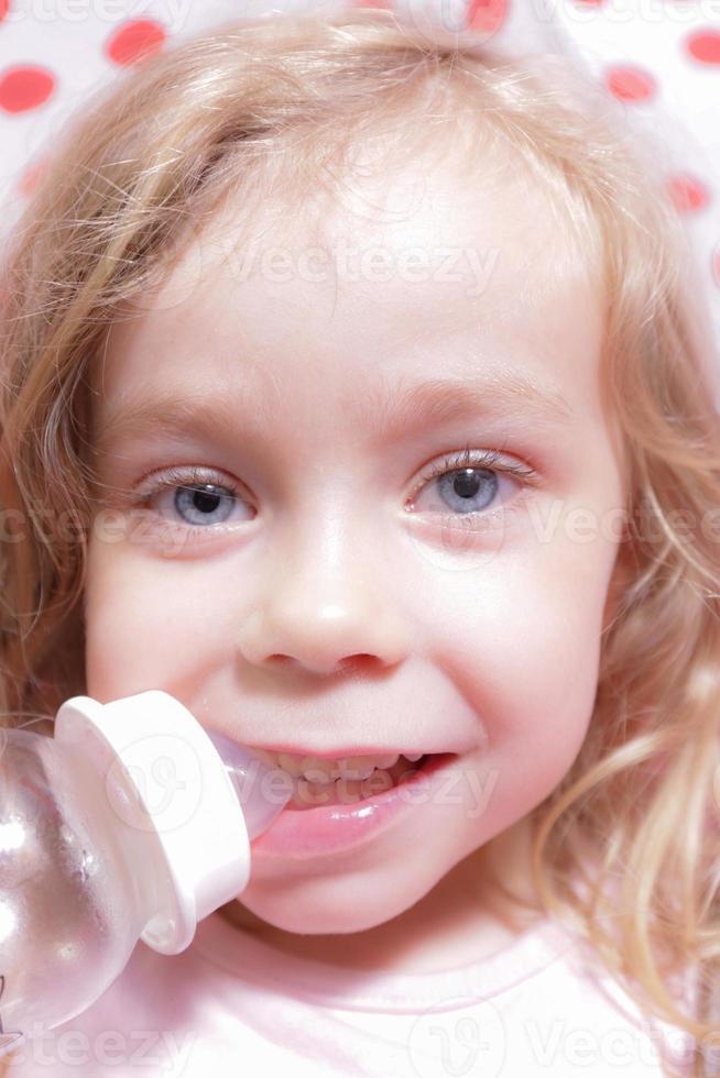 Girl drinking photo