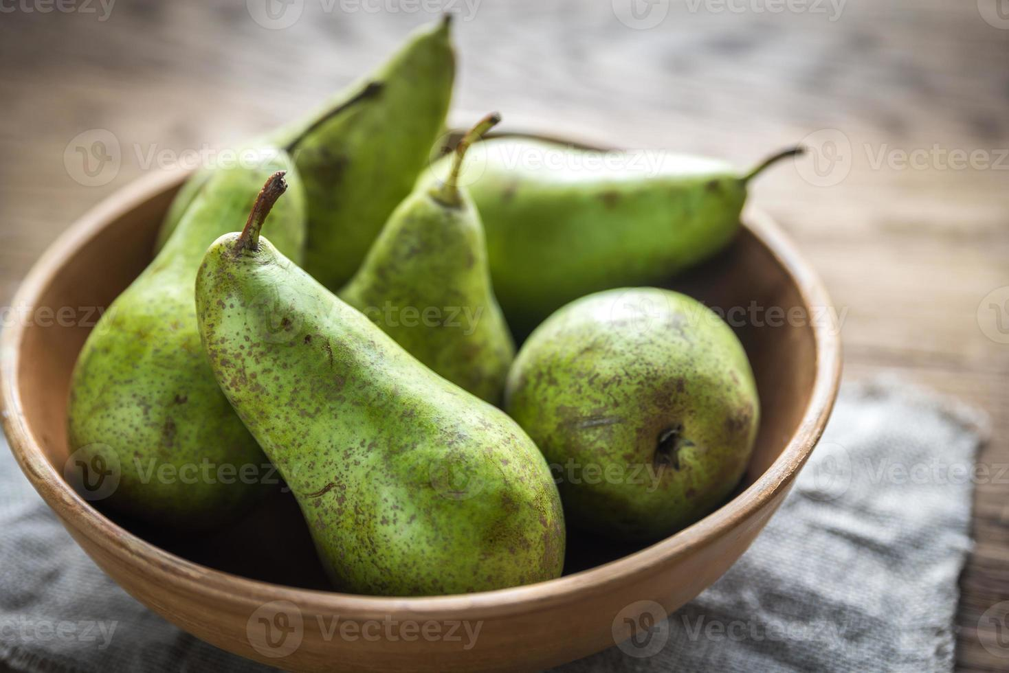 Fresh pears in the rustic bowl photo