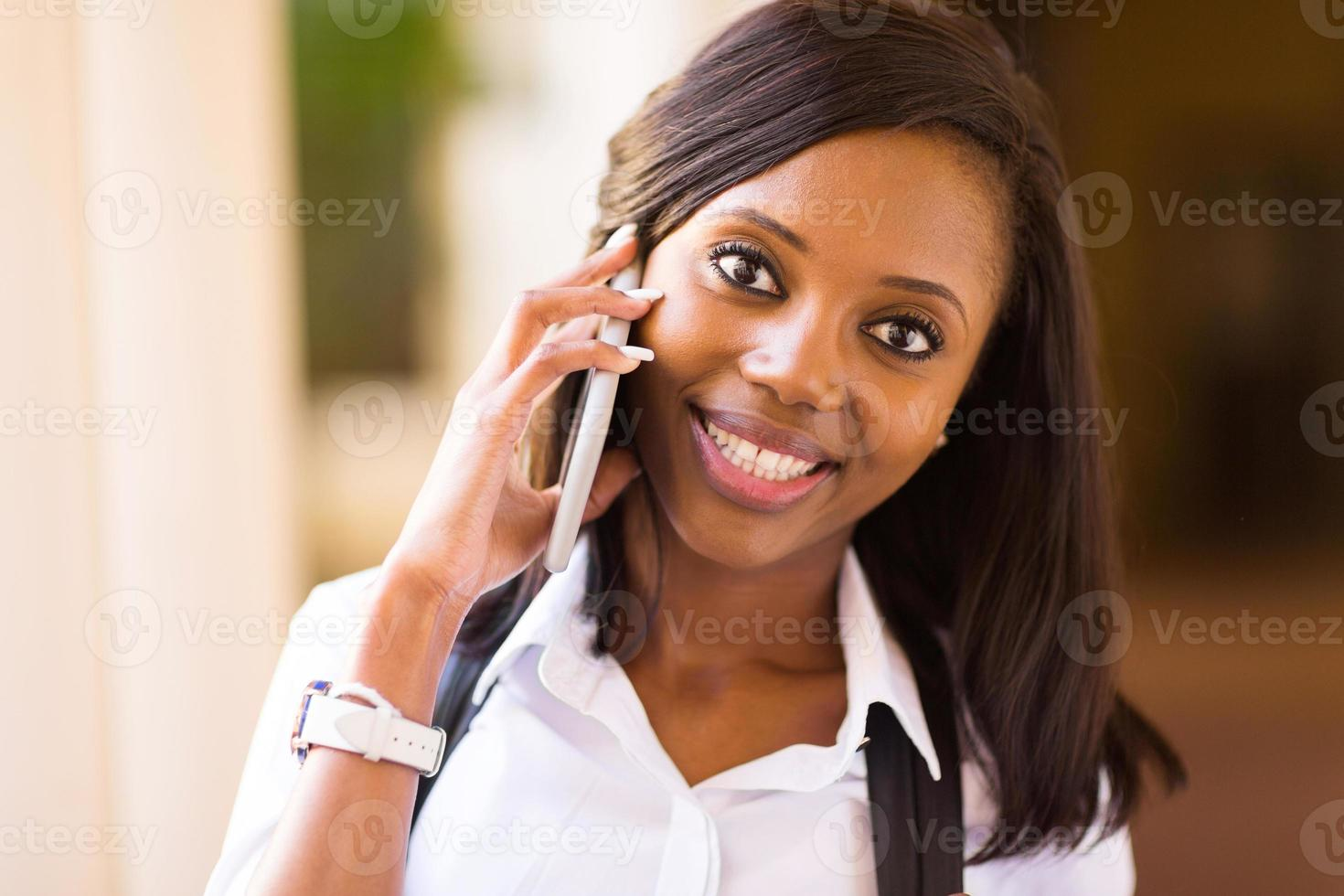 afro american college girl talking on mobile phone photo