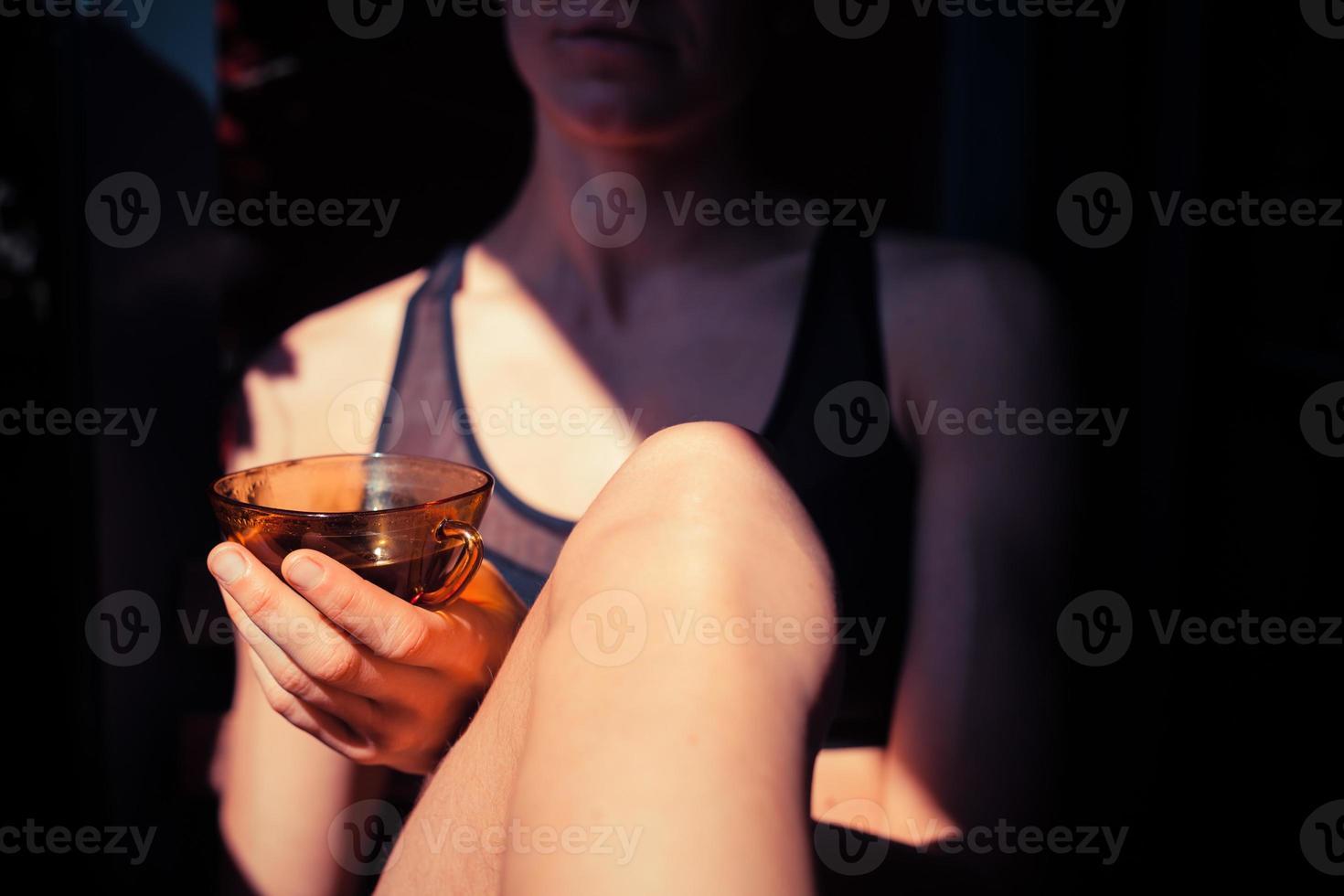 Woman drinking coffee outside photo
