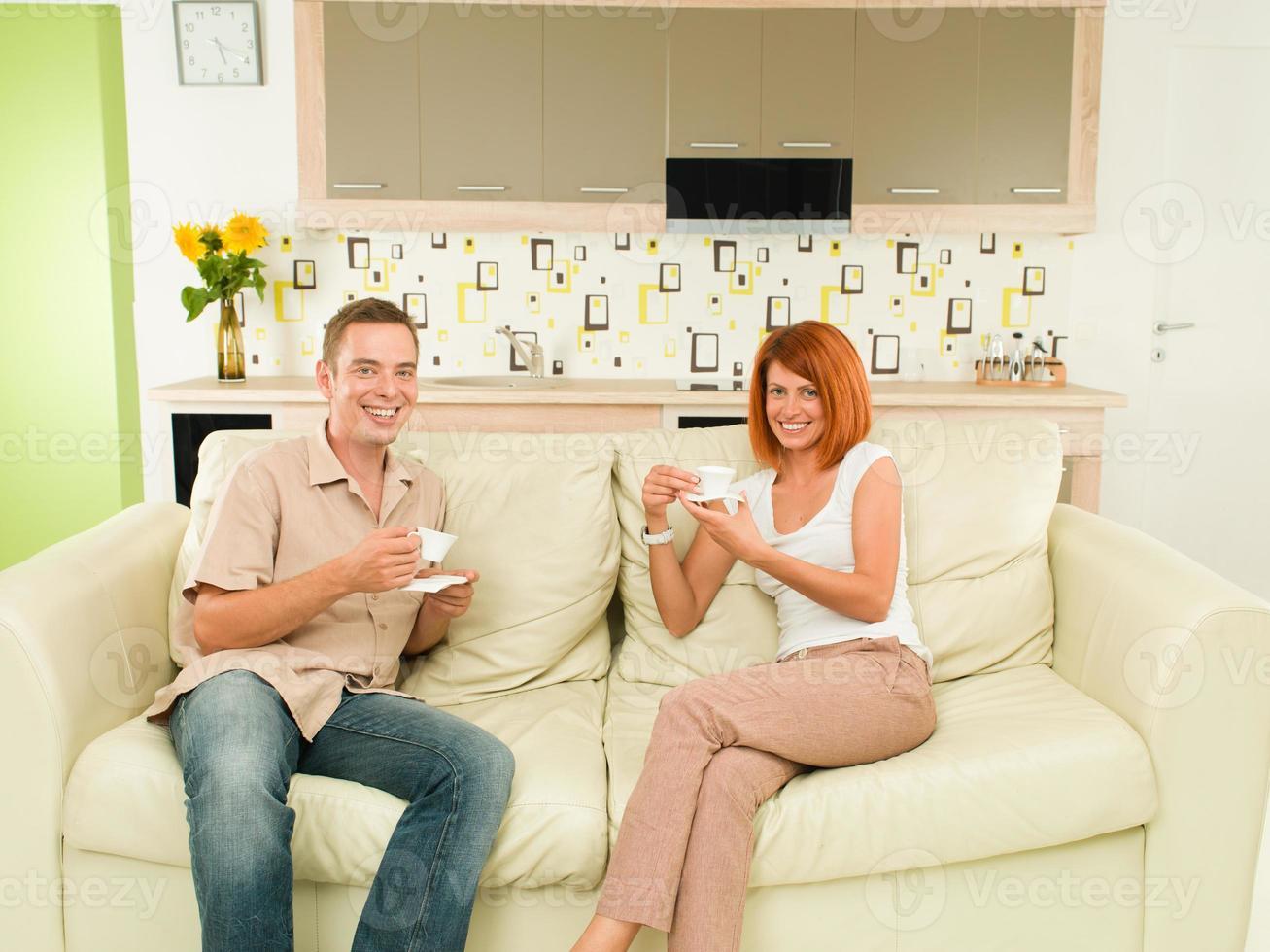 happy couple drinking coffee photo