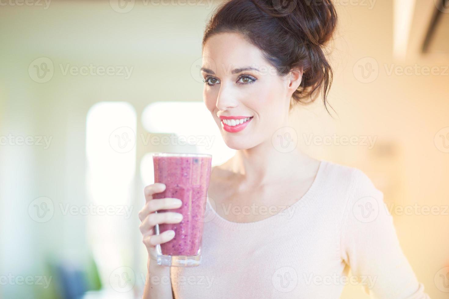 Drinking Fresh Berry Smoothie photo