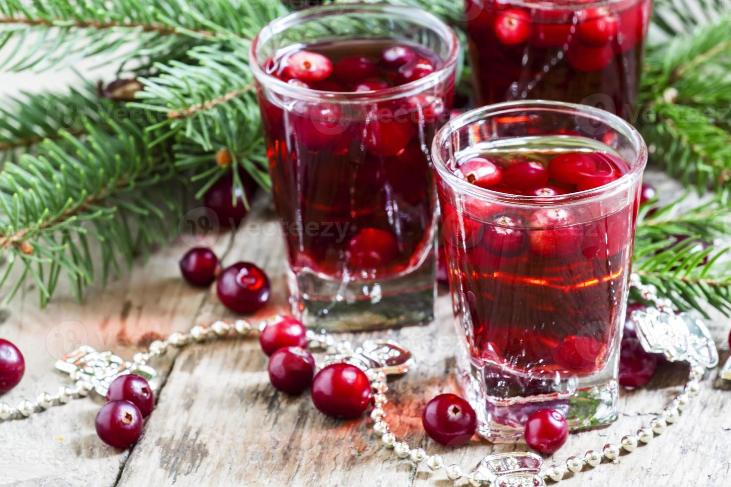 Cranberry drink on Christmas background photo
