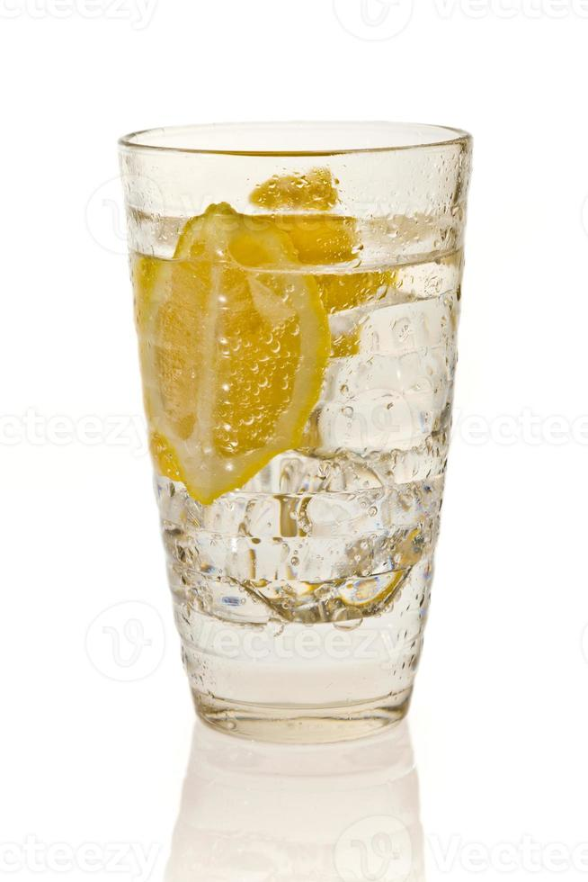 Cold lemon drink with ice photo