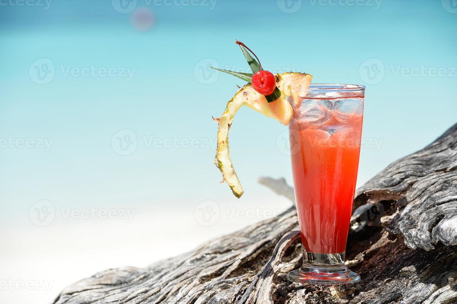 fruity mocktail drink on beach photo