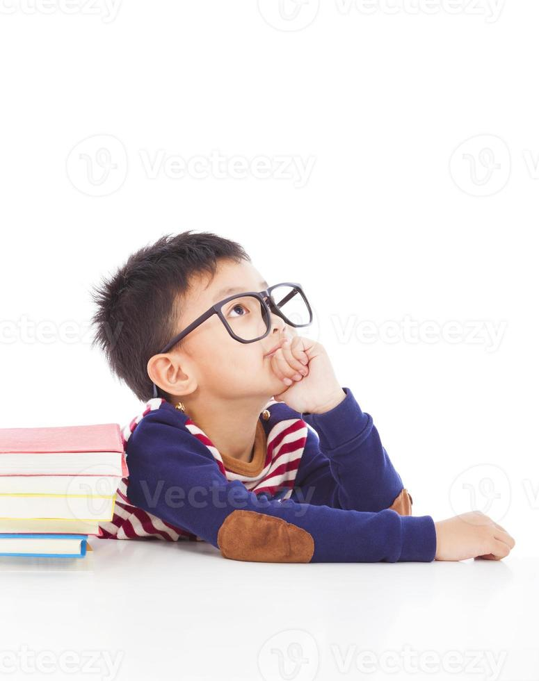 little boy thinking or dreaming photo