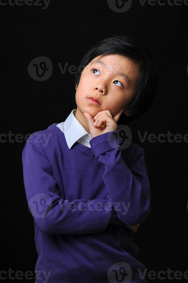 Young boy thinking photo