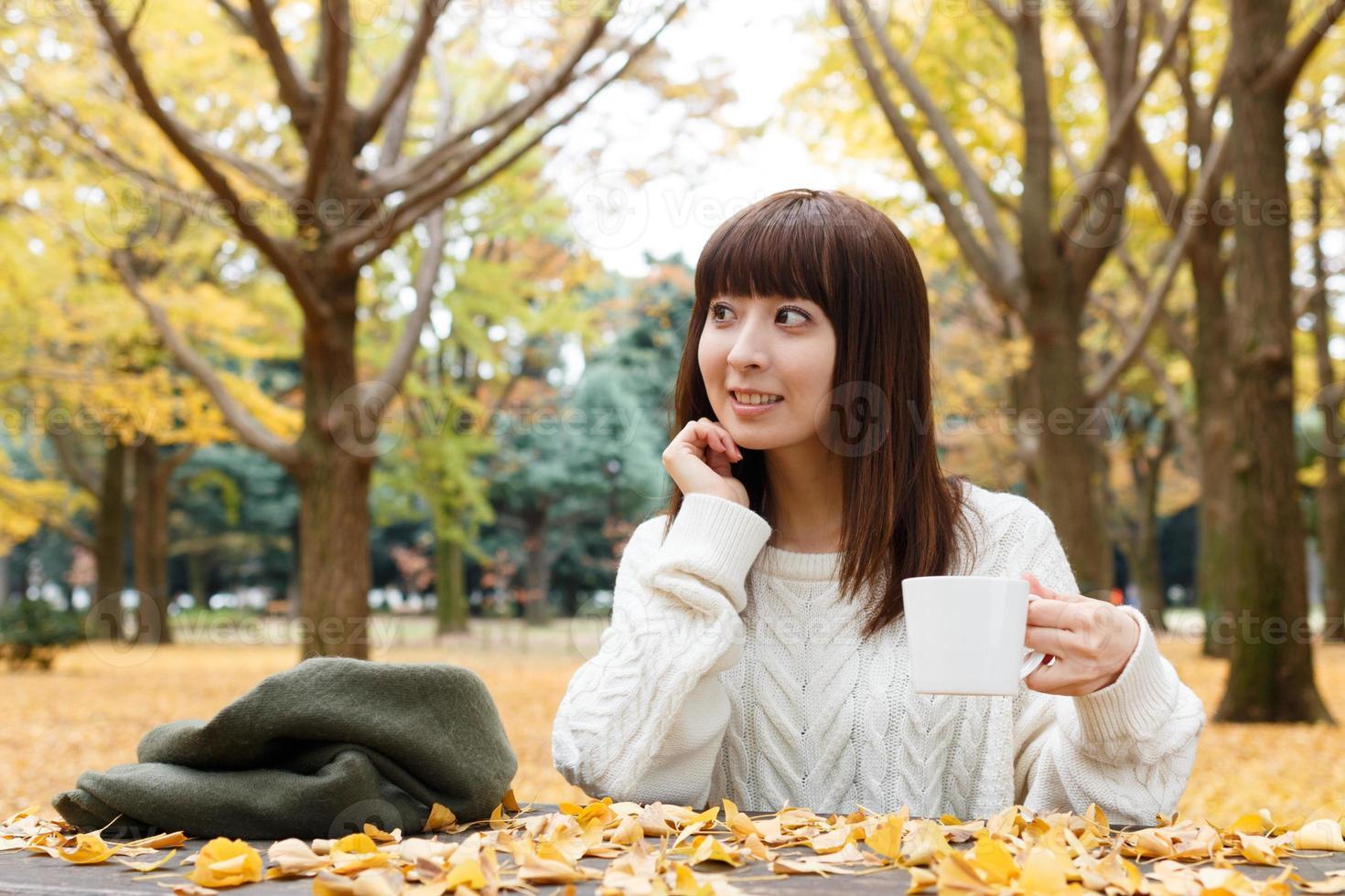 Woman who drinks coffee photo