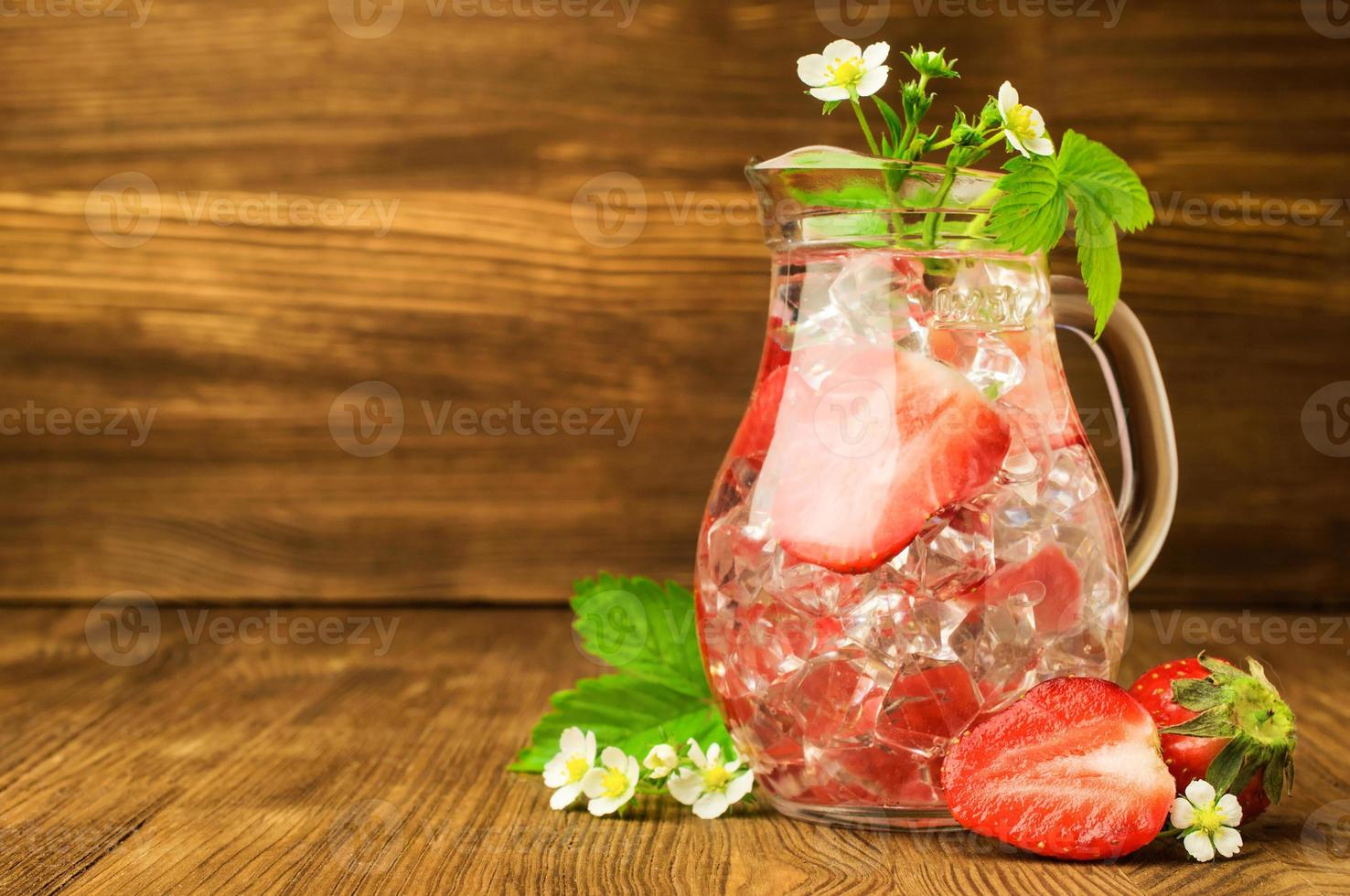 refreshing drink with a strawberry photo