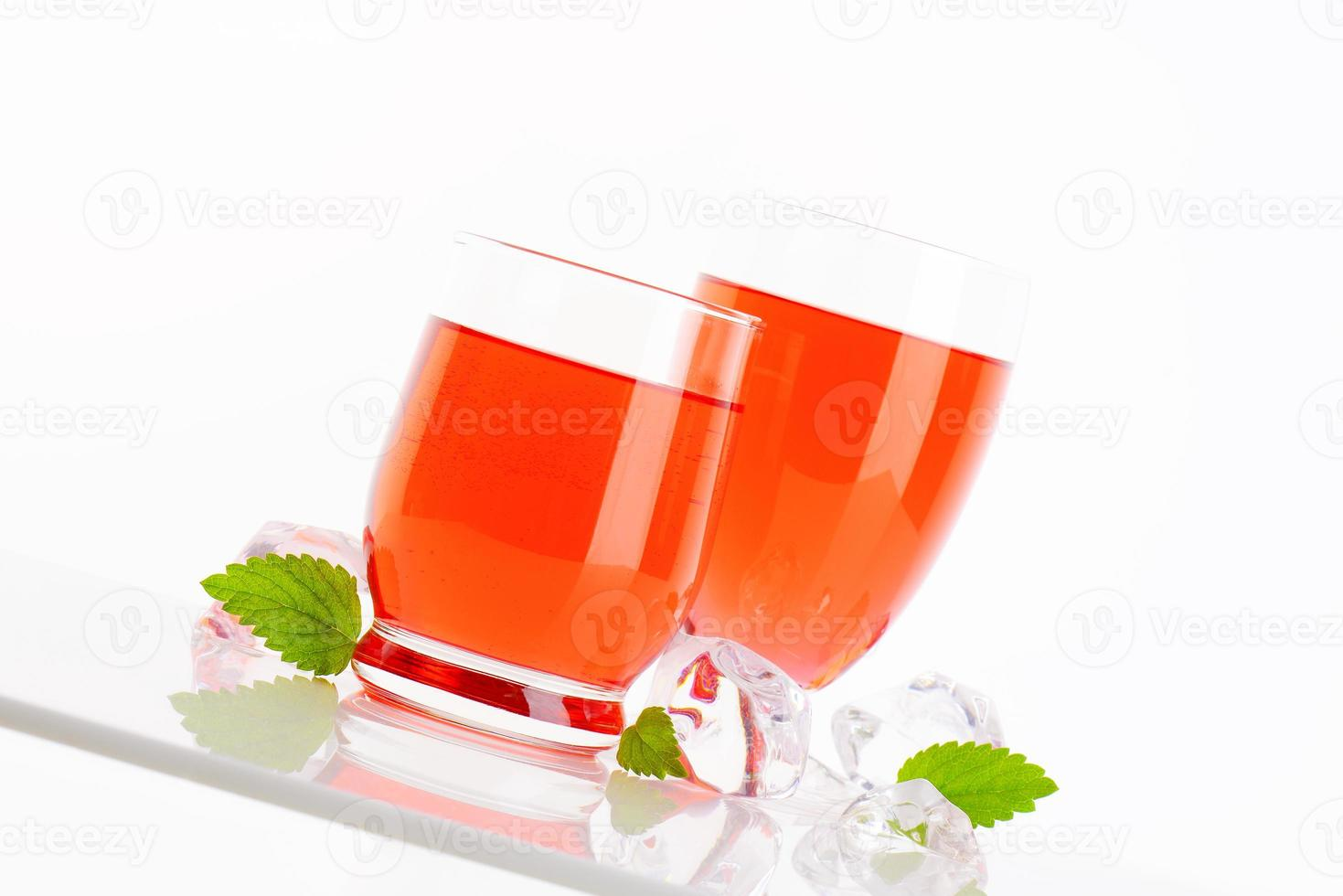 Glasses of fruit flavored drinks photo